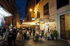 Street restaurants in Trevi district at night, Rome, Italy royalty free stock photography