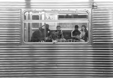 People sitting in a subway car seen through window . Royalty Free Stock Image