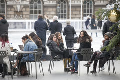 People sitting at the table at the Annual Christmas Ice Rink at the Historic Somerset House Stock Image