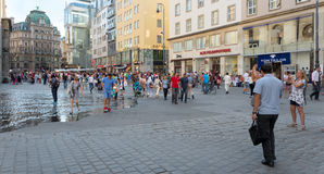 People sitting at the tables in Vienna. VIENNA, AUSTRIA - JULY 31, 2015: people walking in the historic Stephansplatz center of Vienna on  july 31, 2015 in Stock Photography