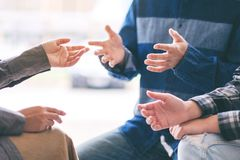 People having conversation together. People sitting and talking together stock photography