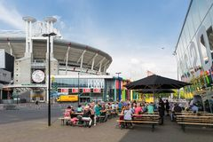 People sitting at a terrace near a Dutch soccer stadium in Amsterdam Royalty Free Stock Images