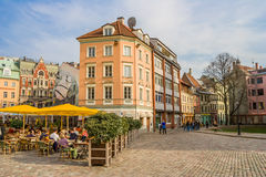 People sitting under umbrellas at the central square in Riga Royalty Free Stock Photo