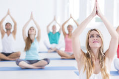 People sitting in yoga position Stock Photography