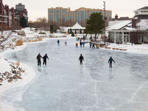 People skate at early evening on a frozen lake. Minnesota, USA Royalty Free Stock Photo