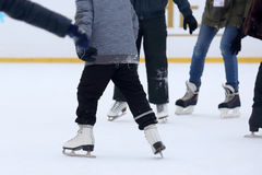 People skate on the ice rink Royalty Free Stock Image