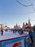 People skate, Red Square. Moscow - November 29, 2015: Big beautiful outdoor skating rink on Red Square, Christmas ornaments and people walking in the days of Royalty Free Stock Images