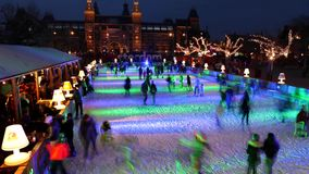 People skate on winter ice skating rink in front of the Rijksmuseum stock video