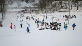 People with skateboards and ski in Kiev, Ukraine, stock footage