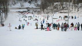 Winter sport entertainment, people with skateboards and ski, Kiev, Ukraine, stock footage