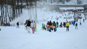 People with skateboards and ski, Kiev, Ukraine, stock footage