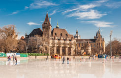 People are skating in front of Vajdahunyad castle in Budapest. BUDAPEST, HUNGARY - FEBRUARY 22, 2016: People are skating in front of Vajdahunyad castle in Royalty Free Stock Image
