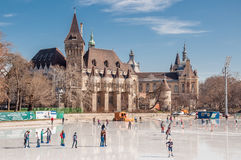 People are skating in front of Vajdahunyad castle in Budapest Royalty Free Stock Photo