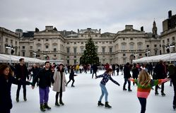 People skating on ice at the Somerset House Christmas Ice Rink. London, United Kingdom, December 2018. royalty free stock images