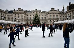 People skating on ice at the Somerset House Christmas Ice Rink. London, United Kingdom, December 2018. stock photos