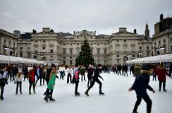 People skating on ice at the Somerset House Christmas Ice Rink. London, United Kingdom, December 2018. stock photography