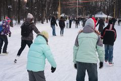 People on skating rink in park Stock Images