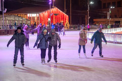 People skating at winter night Stock Photography
