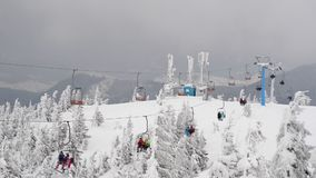 People on a ski lift stock video