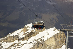 People on the ski lift in Switzerland Stock Images