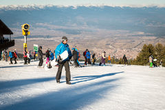 People in ski resort. Snowboarding and skiing Stock Photography