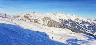 People on ski  and snowboards on winter sport resort in swiss al Royalty Free Stock Images