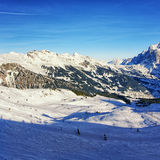 People on ski  and snowboards on winter sport resort in swiss al Royalty Free Stock Photo