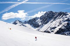 People on ski, snowy mountains, St. Jakob, Defereggen Valley, Austria. People on ski in snowy mountains in the ski resort of St. Jakob in the Defereggen Valley Stock Photography