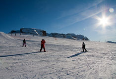 People skiing. In the sun at Madonna di Campiglio ski area, near Grostè. Madonna di Campiglio is one of the most famous area in Italian Alps, in the Domomites Royalty Free Stock Photo