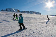 People skiing. In the sun at Madonna di Campiglio ski area, near Grostè. Madonna di Campiglio is one of the most famous area in Italian Alps, in the Domomites Stock Images