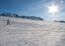 People skiing. Teen skiing in the sun at Madonna di Campiglio ski area, near Grostè. Madonna di Campiglio is one of the most famous area in Italian Alps, in the Royalty Free Stock Photo