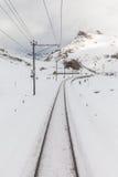 People skiing along the tracks of Bernina Express Royalty Free Stock Photo