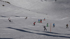 People skiing in alpine ski resort. stock video footage