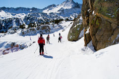 People are skiing in Andorra. Several people are skiing on mountains in Alps Stock Photo