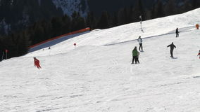People Skiing On Dolomites Mountains Italy. Large group of people skiing and snowboarding on Dolomites mountain in Italy