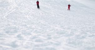 People Skiing Down the Hill. Wide Shot of People Skiing Down the Hill stock video