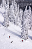 People skiing down the slope Royalty Free Stock Photo