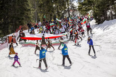 People skiing dressed with traditional bulgarian clothes. Royalty Free Stock Photography