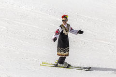 People skiing dressed with traditional bulgarian clothes. Stock Images
