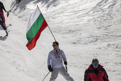 People skiing dressed with traditional bulgarian clothes. Royalty Free Stock Images