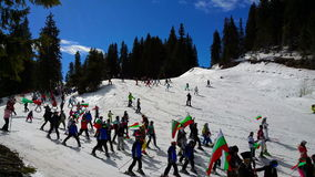 People skiing dressed with traditional bulgarian clothes. stock video footage