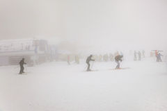 People skiing on extreme weather with fog and zero visibility Royalty Free Stock Image
