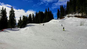 People skiing at Pamporovo ski resot in Bulgaria stock video footage