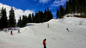 People skiing at Pamporovo ski resot in Bulgaria stock video