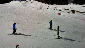 People skiing at Pamporovo ski resot in Bulgaria stock footage