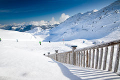 People skiing on the prepared slope with fresh new powder snow i stock photo