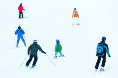 People Skiing on a slope Stock Images