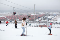 People skiing on the slopes Stock Images