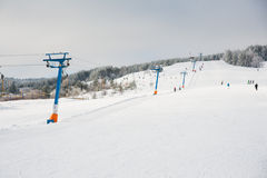 People skiing and snowboarding on a slope Royalty Free Stock Image