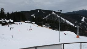 People skiing and snowboarding on snow slope in winter ski resort. Ski elevator on snow mountain. Winter activity on ski resort 20 stock video footage